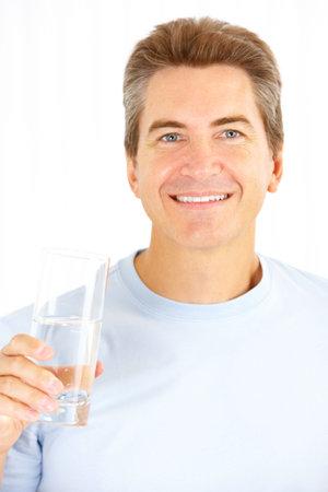 man drinking water: Handsome smiling man drinking water  Stock Photo