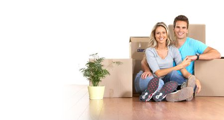 Young couple sitting on the floor after moving  photo
