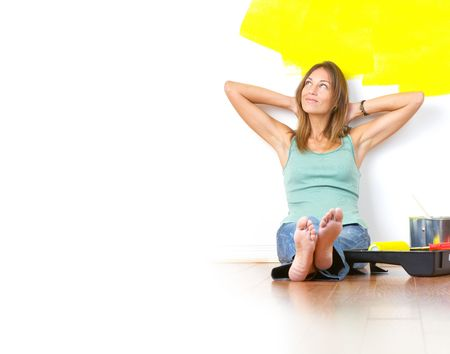 smiling beautiful woman painting interior wall of home.  Stock Photo - 5904102