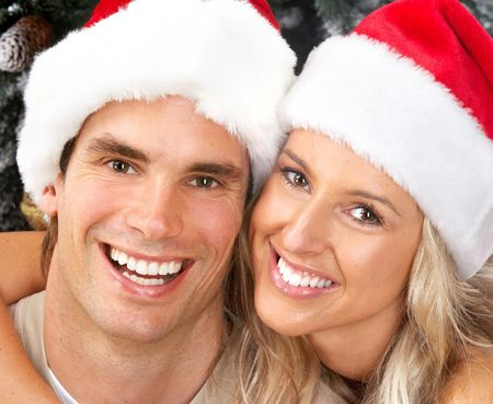 Young happy couple near  a Christmas tree. photo