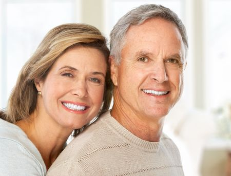 Happy smiling elderly couple at home  photo