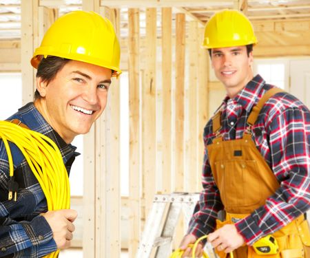 Smiling handsome builder in yellow uniform.   photo