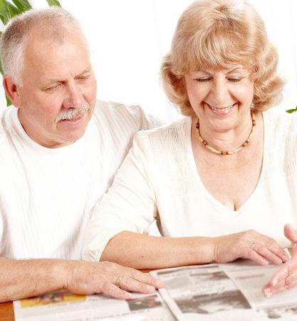 senior couple reading a magazine  at home Stock Photo - 5955249