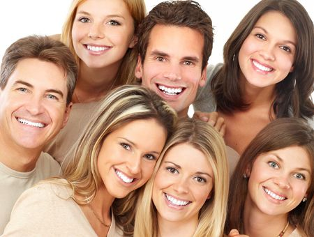 Happy funny young people with great smiles photo