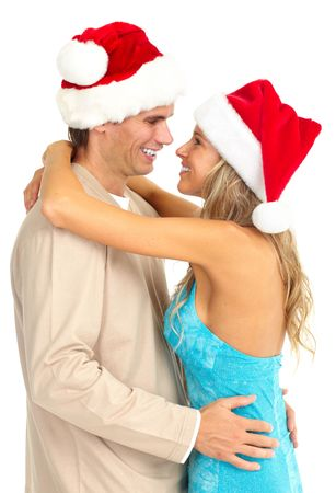 Young happy couple in Christmas hats. Isolated over white background  photo