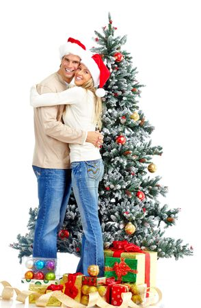 happy christmas: Young happy couple near  a Christmas tree. Over white background