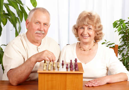 Senior couple  playing chess at home Stock Photo - 6024143