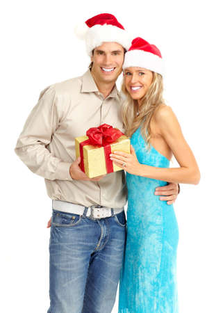 Young happy couple with a Christmas gift. Isolated over white background
