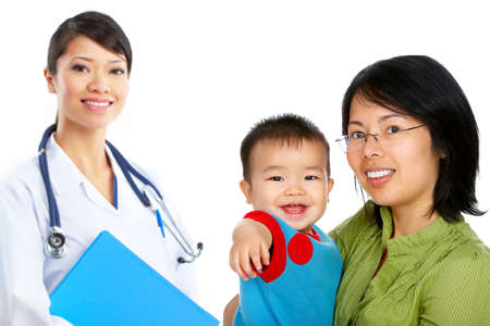 Smiling family medical doctor and mother with baby. Over white background  photo