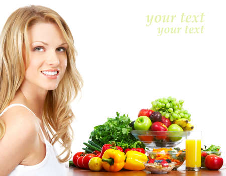 fruit salad: Young smiling woman  with fruits and vegetables. Over white background