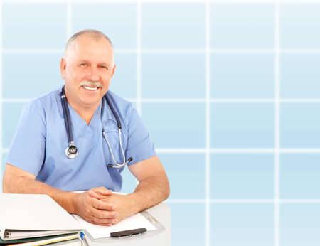 Smiling medical doctor with stethoscope. Over blue background Stock Photo - 6024319