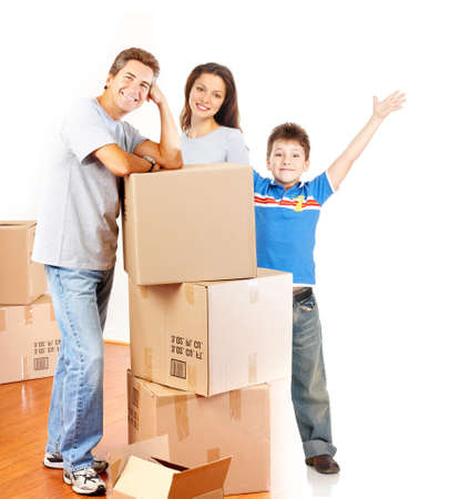 packing boxes: Young happy family moving into their new home   Stock Photo