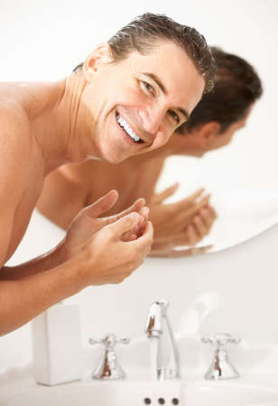 wash:  handsome man washing in the bathroom