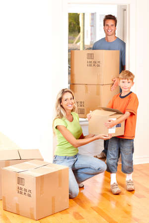 moving box: Young happy family moving into their new home   Stock Photo