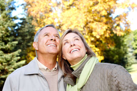 retired: Happy elderly seniors couple in park  Stock Photo