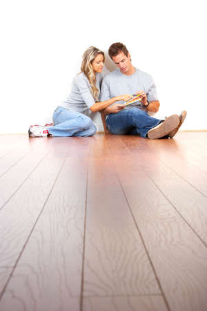 smiling couple choosing color for the  interior wall of home.   photo