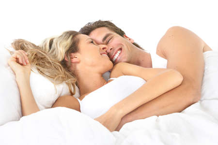 adult sexual: Young happy couple in bed  Stock Photo