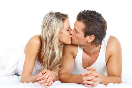 Young happy couple in bed Stock Photo - 6109570