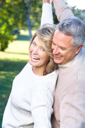mature male: Happy elderly seniors couple in park Stock Photo