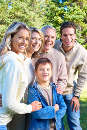 Happy family in park. Grandfather, grandmother, father, mother and son Stock Photo - 6116273