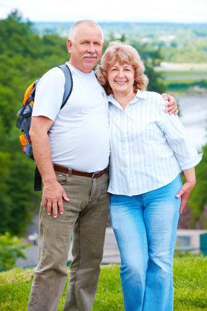 Happy elderly seniors couple in park Stock Photo - 6116072