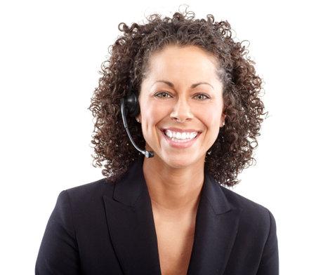 telephone headsets: Mujer de negocios hermoso con auriculares. Sobre fondo azul  Foto de archivo