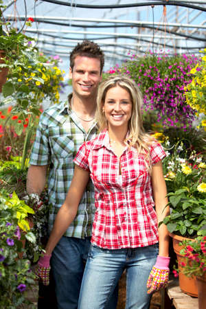 Young smiling people florists working in the garden Stock Photo - 6163331