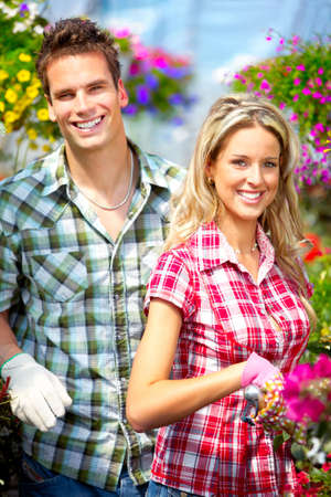 Young smiling people florists working in the garden Stock Photo - 6163319