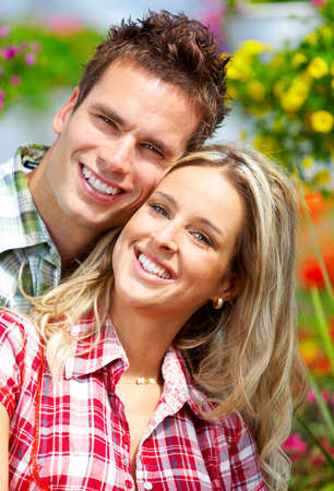 Young  happy smiling couple in love Stock Photo - 6163333