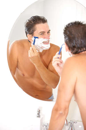 fourties:  handsome man shaving in the bathroom