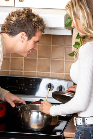 Young love couple cooking at the kitchen  photo