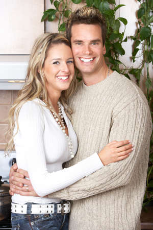 settler: Young happy  couple in love at home