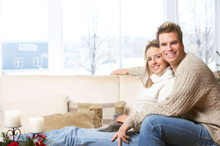 window  glass: Young couple in love at home