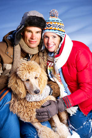 winter fashion: Young  happy smiling couple with dog. Winter  Stock Photo