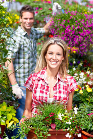 Young smiling people florists working in the garden  photo