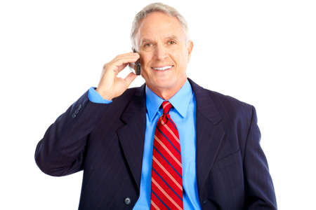 Smiling handsome businessman talking by cellular  photo