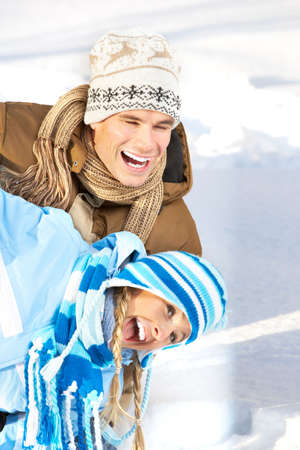 Young  happy smiling couple in love. Winter  Stock Photo