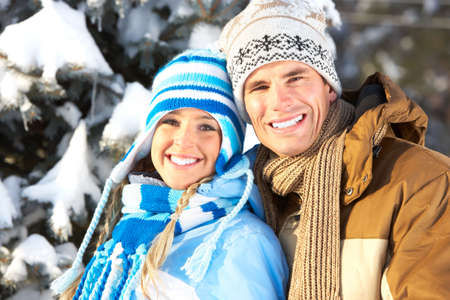 euphoria: Young  happy smiling couple in love. Winter  Stock Photo