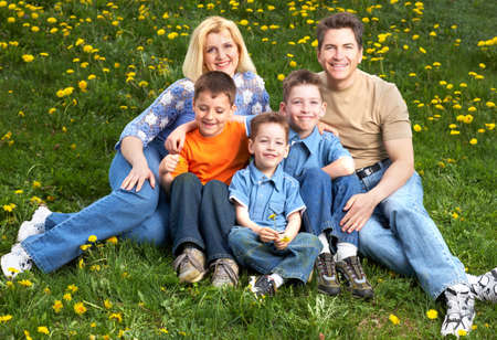 Happy family. Father, mother and sons in the park