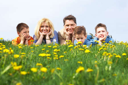 mom and dad: Happy family. Father, mother and sons in the park  Stock Photo