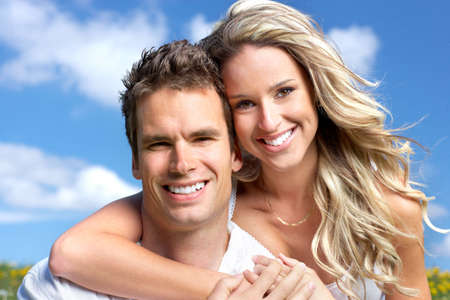 Young love couple smiling under blue sky Stock Photo - 6172307