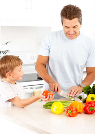 father and child: Happy family. Father and son cooking  at kitchen