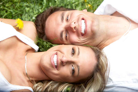 Young love couple on green grass  photo