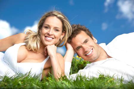 Young love couple smiling under blue sky Stock Photo - 6184291