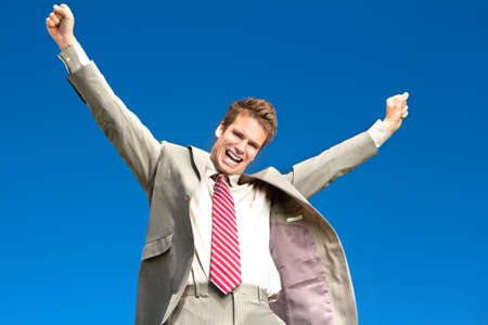 Happy successful  businessman  under blue sky.   photo