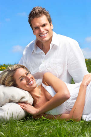 Young love couple smiling under blue sky Stock Photo - 6184448