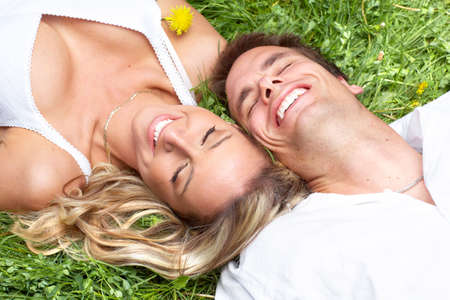 Young love couple sleeping on green grass photo