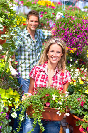 Young smiling people florists working in the garden Stock Photo - 6184451