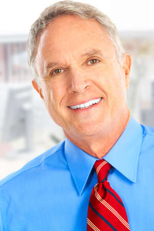 Smiling mature  businessman in the office photo