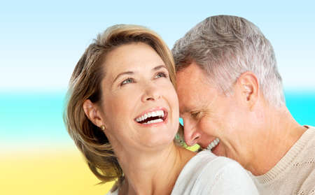 a young old couple: Happy elderly seniors couple in love outdoor Stock Photo